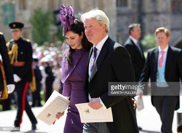 Prince Harry's Uncle Charles Spencer and Karen Spencer leave after attending the wedding ceremony of Britain's Prince Harry Duke of Sussex and US...