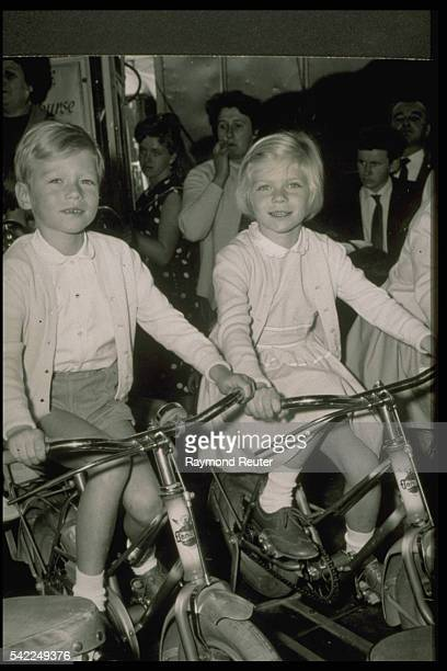 Prince Henri and Princesse MarieAstrid on a merrygoround in 1960