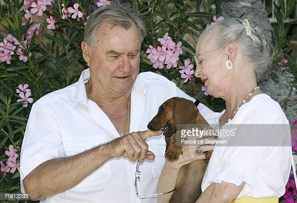 Prince Henrik of Denmark and Queen Margrethe II of Denmark and her dog Helike pose during the annual photocall in their summer residence on August 9,...