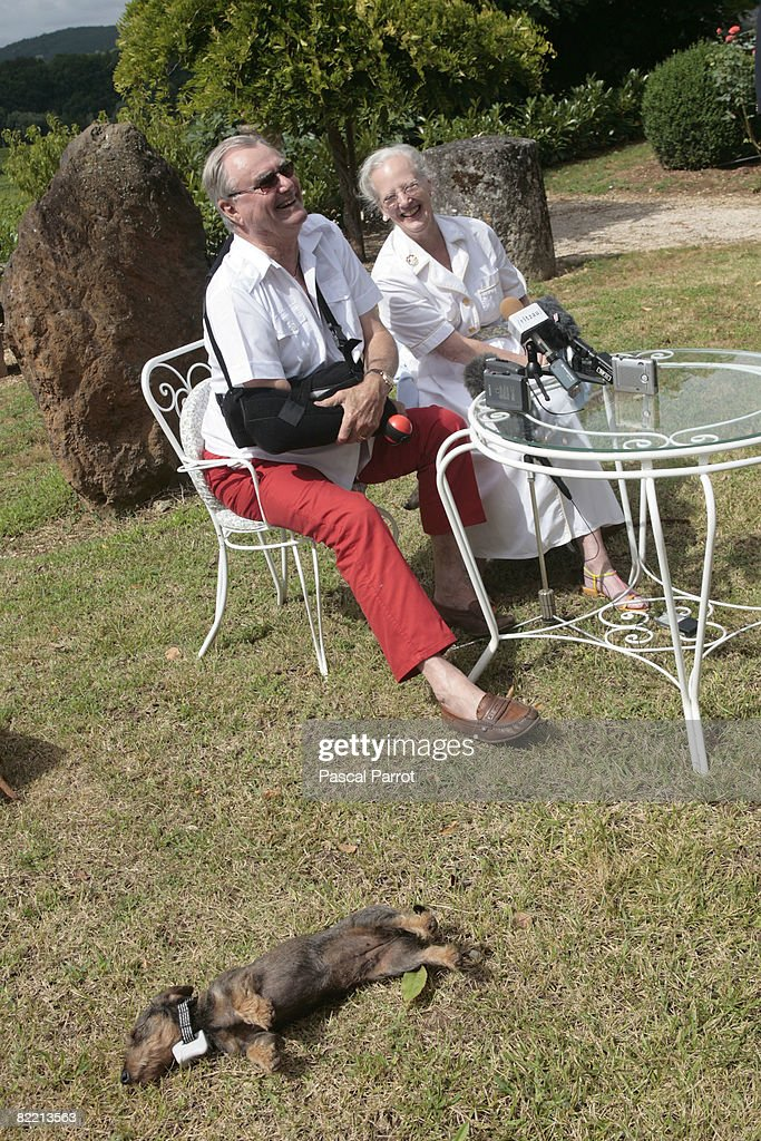 Prince Henrik of Denmark(L) and the Queen Margrethe II of Denmark (R) pose with their dog Vega for holiday pictures during the photocall on August 8, 2008 in Caix, France.