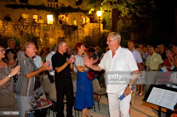Prince Henrik of Denmark attends a summer concert with the Royal Guards Band in the park at the Chateau de Cayx on August 21 in Luzech France
