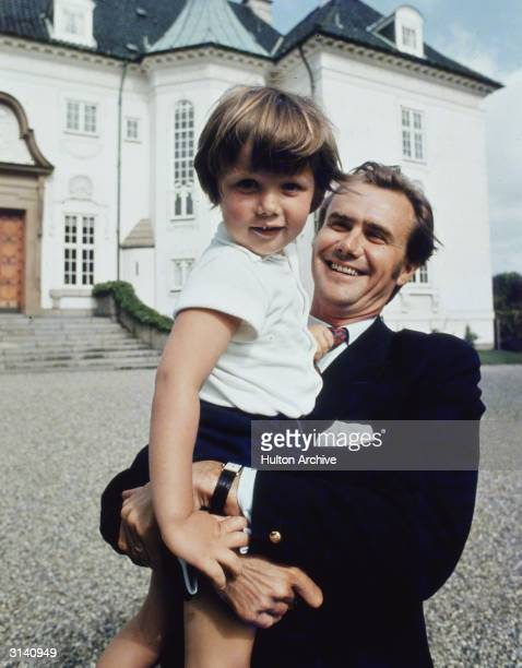 Prince Henrik of Denmark the husband of Queen Margrethe with their son Crown Prince Frederik during a holiday at Marselisborg Castle Aarhus Jutland