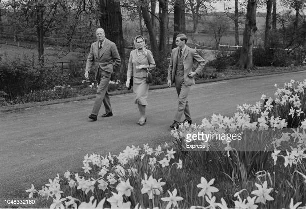 Prince Henry, Duke of Gloucester pictured on left with Princess Alice, Duchess of Gloucester and their son Prince Richard walking along a drive in...