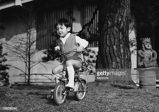 Prince Hiro, aka Crown Prince Naruhito of Japan, cycling in the palace grounds in Tokyo on his 5th birthday, 23rd February 1965.