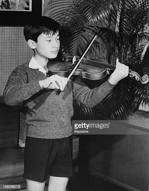 Prince Hiro aka Crown Prince Naruhito of Japan practises the violin at Togu Palace in Tokyo February 1972