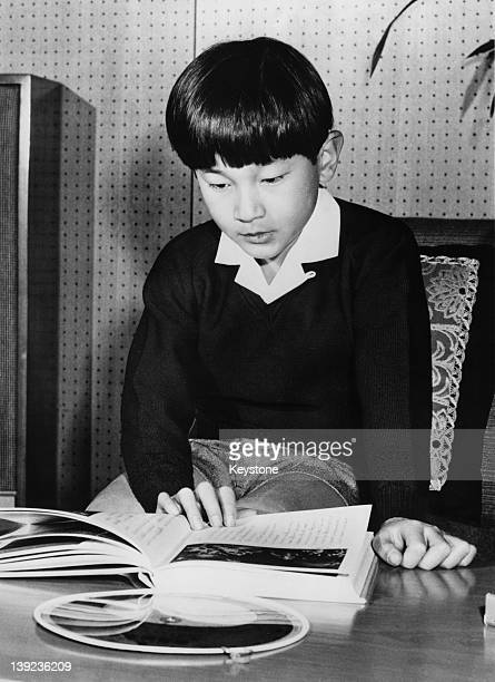 Prince Hiro aka Crown Prince Naruhito of Japan studying a book of astrological charts shortly after his 10th birthday February 1970