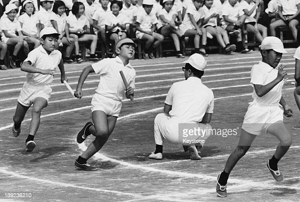 Prince Hiro aka Crown Prince Naruhito of Japan takes part in a relay race during an athletic meeting of his school in Tokyo 1970