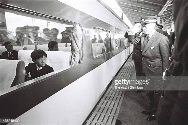 Prince Hiro or Prince Naruhito is seen on board at Shinkansen bullet train while staffs of Tokyo station salute on November 11 1968 in Tokyo Japan