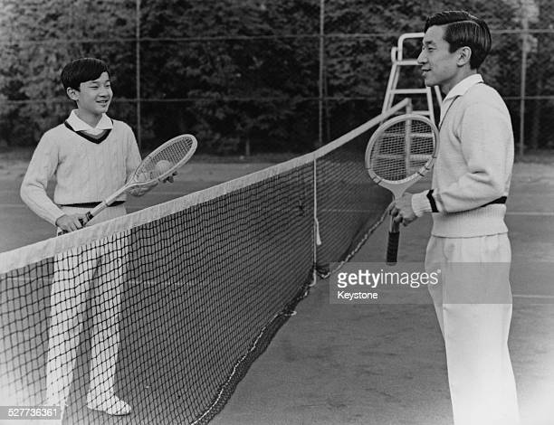 Prince Hiro the eldest son of Emperor Akihito and Empress Michiko of Japan playing tennis with his father in Tokyo around the time of his 13th...