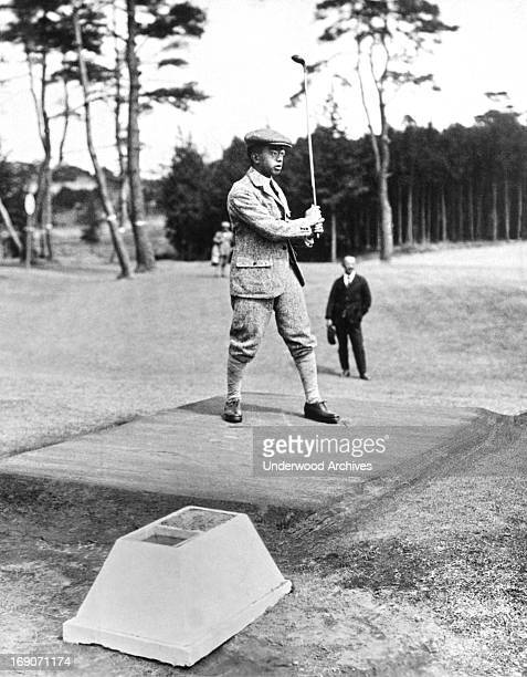 Prince Hirohito watches his ball after his drive at the Tokyo Golf Club, Tokyo, Japan, August 16, 1926.
