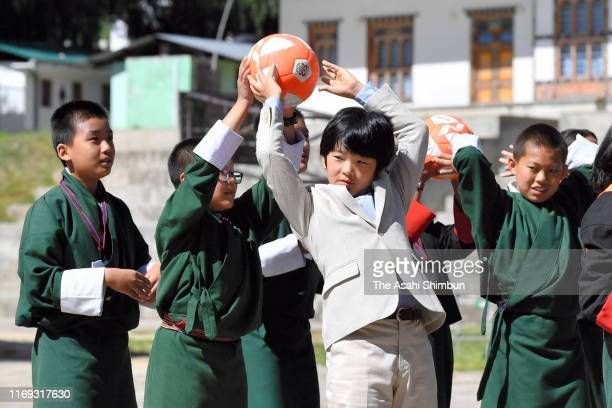 Prince Hisahito plays with local children as he visits a school on August 20 2019 in Thimphu Bhutan