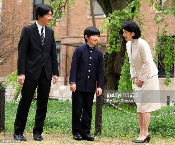 Prince Hisahito poses for photographs with his parents Prince Akishino and Princess Kiko prior to attending the welcome ceremony at the Ochanomizu...