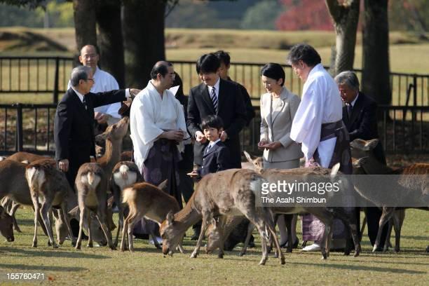 Prince Hisahito, Prince Akishino and Princess Kiko are seen during the Shikayose, heading deers by blowing horn, at Tobihino Field of Kasuga Taisha...