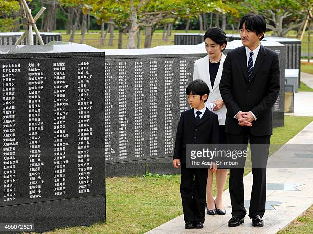 Prince Hisahito , Prince Akishino and Princess Kiko of Akishino visit the Heiwa-no-Ishiji, at Mabuni-no-Oka, Peace Memorial Park on December 10, 2013...