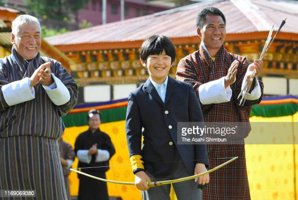 Prince Hisahito smiles after trying Bhutan's traditional archery at the Changlingmethang National Archery ground on August 19 2019 in Thimphu Bhutan