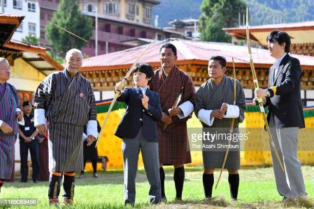 Prince Hisahito tries Bhutan's traditional archery while Crown Prince Fumihito or Crown Prince Akishino at the Changlingmethang National Archery...