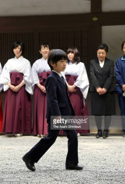 Prince Hisahito walks in front of Kaguraden Hall during the visit to Ise Shrine on March 25, 2013 in Ise, Mie, Japan.