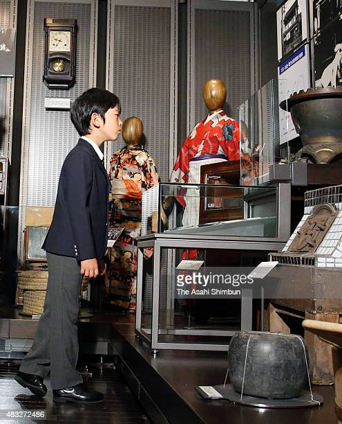 Prince Hisahito watches exhibits during his visit to the National Showa Memorial Museum ahead of the 70th anniversary of Japan's WWII surrender on...