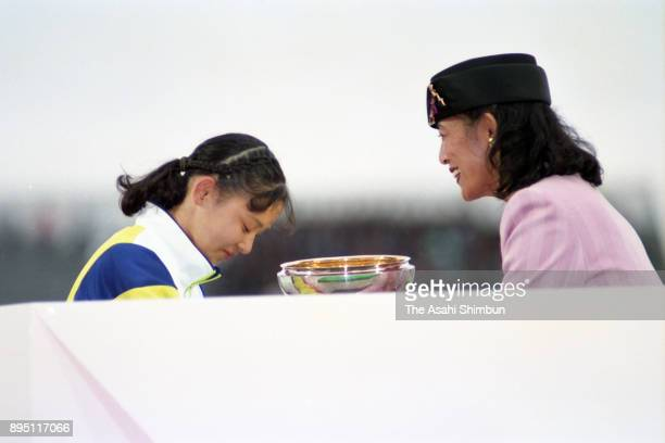 Prince Hisako of Takamado presents the trophy to a representative of Kagawa Prefeture during the closing ceremony of the National Sports Festival at...
