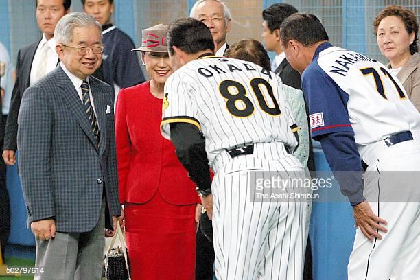 Prince Hitachi and Princess Hanako of Hitachi greet head coaches prior to the professional baseball game between Orix Buffaloes and Hanshin Tigers at...