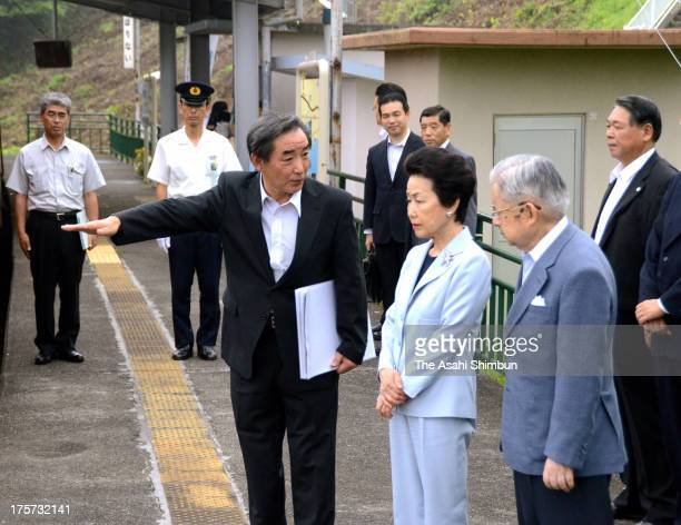 Prince Hitachi and Princess Hanako of Hitachi listen to the explanation at Sanriku Rias Railways Horiuchi station during their visit to earthquake...
