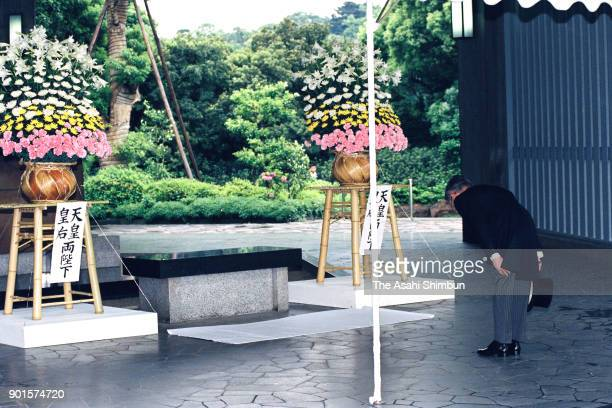 Prince Hitachi attends a memorial ceremony at the Chidorigafuchi National Cemetery on May 27 1991 in Tokyo Japan