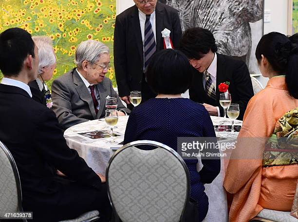 Prince Hitachi speaks to award winners during the reception of the 33rd Ueno Royal Museum Grand Prize Award Ceremony on April 28, 2015 in Tokyo,...