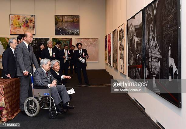 Prince Hitachi watches the artworks at the 33rd Ueno Royal Museum Grand Prize Award Ceremony on April 28, 2015 in Tokyo, Japan.
