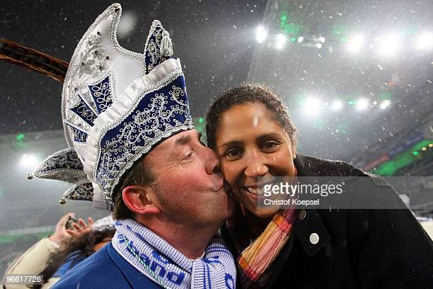 Prince Holger the first of carnival Monchengladbach kisses Steffi Jones President of the Organising Committee Germany ahead of the Bundesliga match...