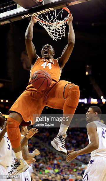 Prince Ibeh of the Texas Longhorns dunks the ball against the Kansas State Wildcats in the first half during the Quarterfinals of the Big 12...