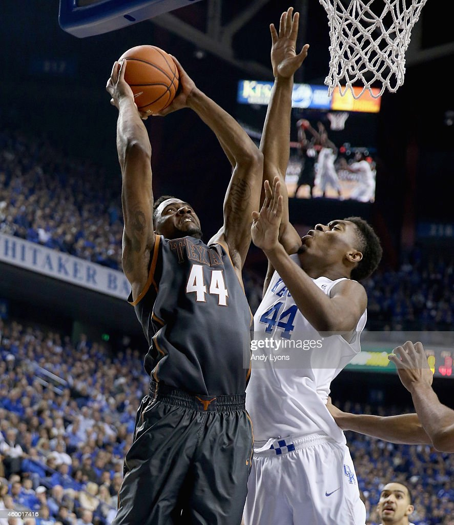 Prince Ibeh #44 of the Texas Longhorns shoots the ball while defended by Dakari Johnson #44 of the Kentucky Wildcats at Rupp Arena on December 5, 2014 in Lexington, Kentucky.