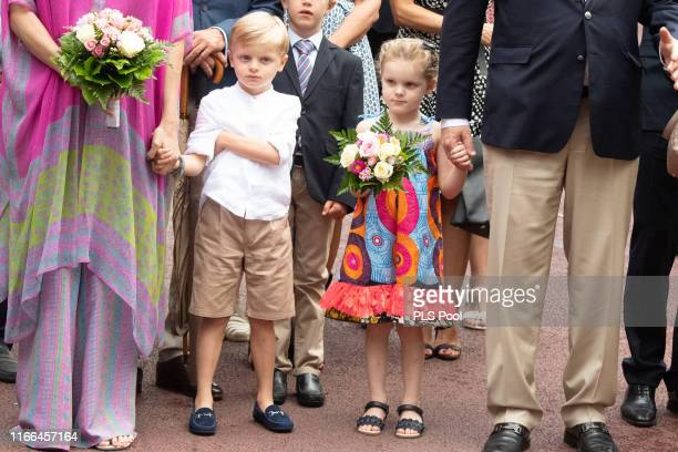 Prince Jacques and Princess Gabriella of Monaco join their parents Prince Albert II of Monaco and Princess Charlene of Monaco attend the traditional...