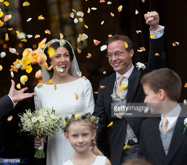 Prince Jaime de Bourbon Parme and Viktoria Cservenyak leave after their wedding at The Church Of Our Lady At Ascension on October 5, 2013 in...