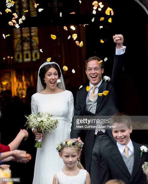 Prince Jaime de Bourbon Parme and Viktoria Cservenyak leave after getting married at The Church Of Our Lady At Ascension on October 5 2013 in...