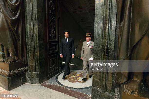 Prince JeanChristophe Napoleon and General Bertrand RactMadoux Governor of the Invalides attend the mass given in memory of the emperor Napoleon at...
