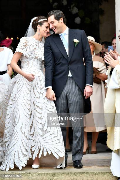 Prince Jean-Christophe Napoleon and his wife Olympia Von Arco-Zinneberg come out of the Cathedral at the end of their Wedding at Les Invalides on...