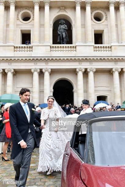 Prince JeanChristophe Napoleon and his wife Olympia Von ArcoZinneberg come out of the Cathedral under the gaze of the statue of Napoleon at the end...