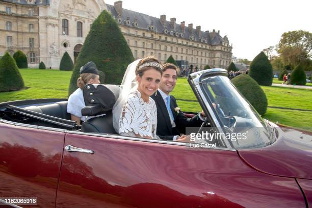 Prince JeanChristophe Napoleon and his wife Olympia Von ArcoZinneberg pose in a car at the end of their wedding at Les Invalides on October 19 2019...