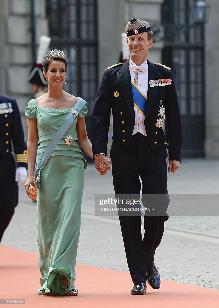 Prince Joachim and Princess Marie of Denmark arrive for the wedding of Sweden's Crown Prince Carl Philip and Sofia Hellqvist at Stockholm Palace on June 13, 2015.