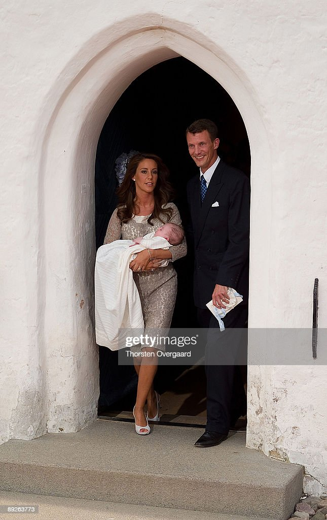 Prince Joachim and Princess Marie present their newly Christened Prince Henrik Carl Joachim Alain of Denmark at Mogeltonder Church on July 26, 2009 in Mogeltonder, Denmark.