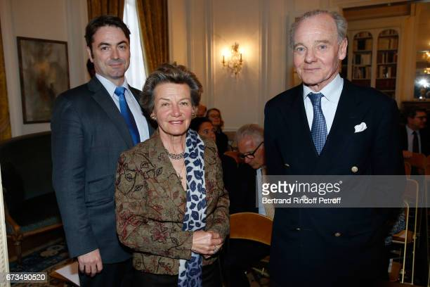 Prince Joachim Murat Princess Suzanne Mourousy and Prince Constantin Mourousy attend the presentation of the Book 'Scenes De Crime au Louvre' written...