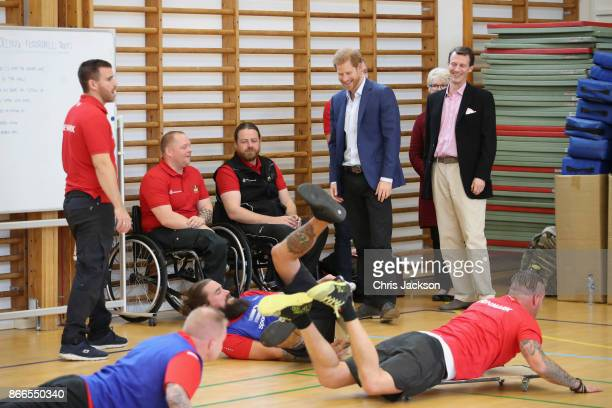 Prince Joachim of Denmark and Prince Harry watch a Rolling Floorball match a sport invented by Danish veterans at the Danish Veteran Centre on...