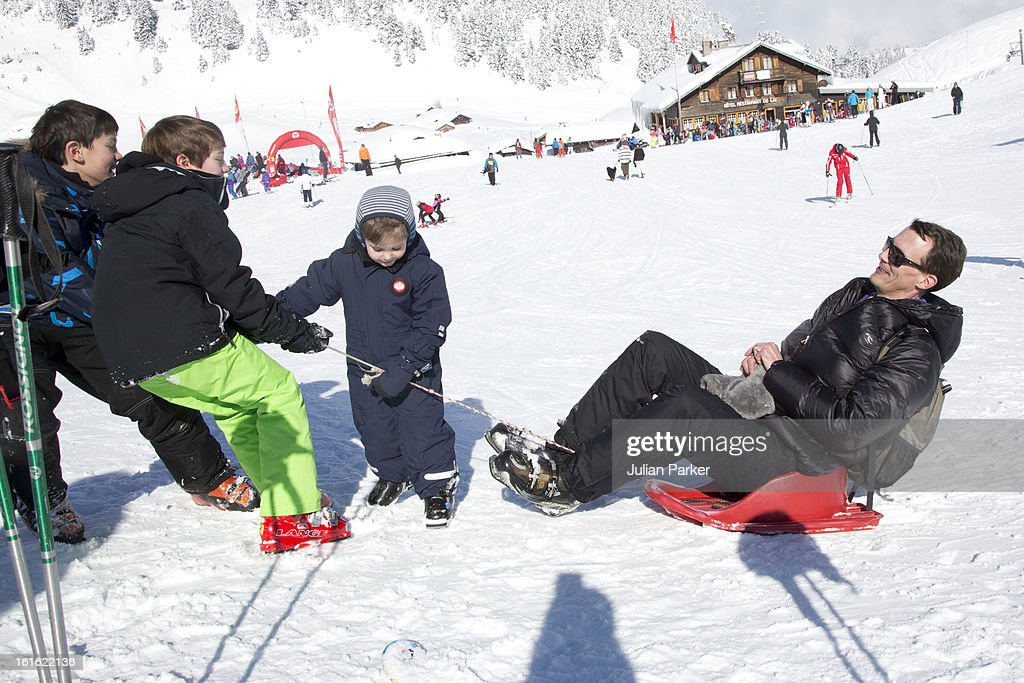 Prince Joachim of Denmark plays with his son's Prince Nikolai, Prince Felix and Prince Henrik during an annual family skiing holiday on February 13, 2013 in Villars-sur-Ollon, Switzerland.