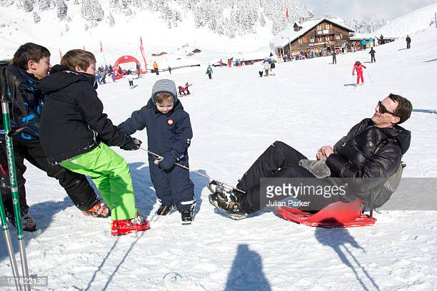 Prince Joachim of Denmark plays with his son's Prince Nikolai Prince Felix and Prince Henrik during an annual family skiing holiday on February 13...