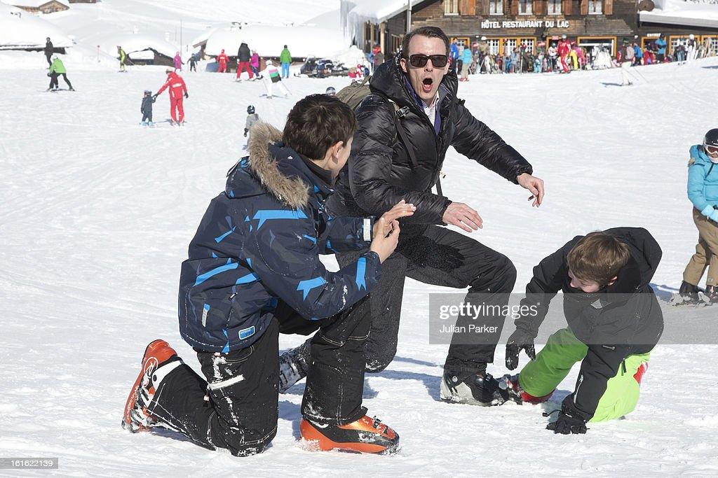 Prince Joachim of Denmark plays with his two son's Prince Nikolai and Prince Felix during an annual family skiing holiday on February 13, 2013 in Villars-sur-Ollon, Switzerland.
