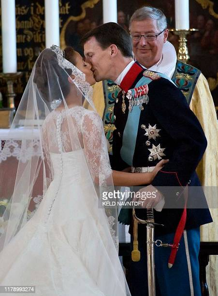 Prince Joachim of Denmark Queen Margrethe's youngest son kisses his bride French Marie Cavallier on May 24 2008 in Moegeltoender Church in South...
