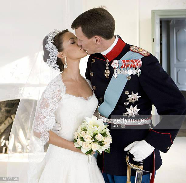 Prince Joachim of Denmark, Queen Margrethe's youngest son, kisses his bride, French Marie Cavallier, now Princesss Marie of Denmark, in this official...
