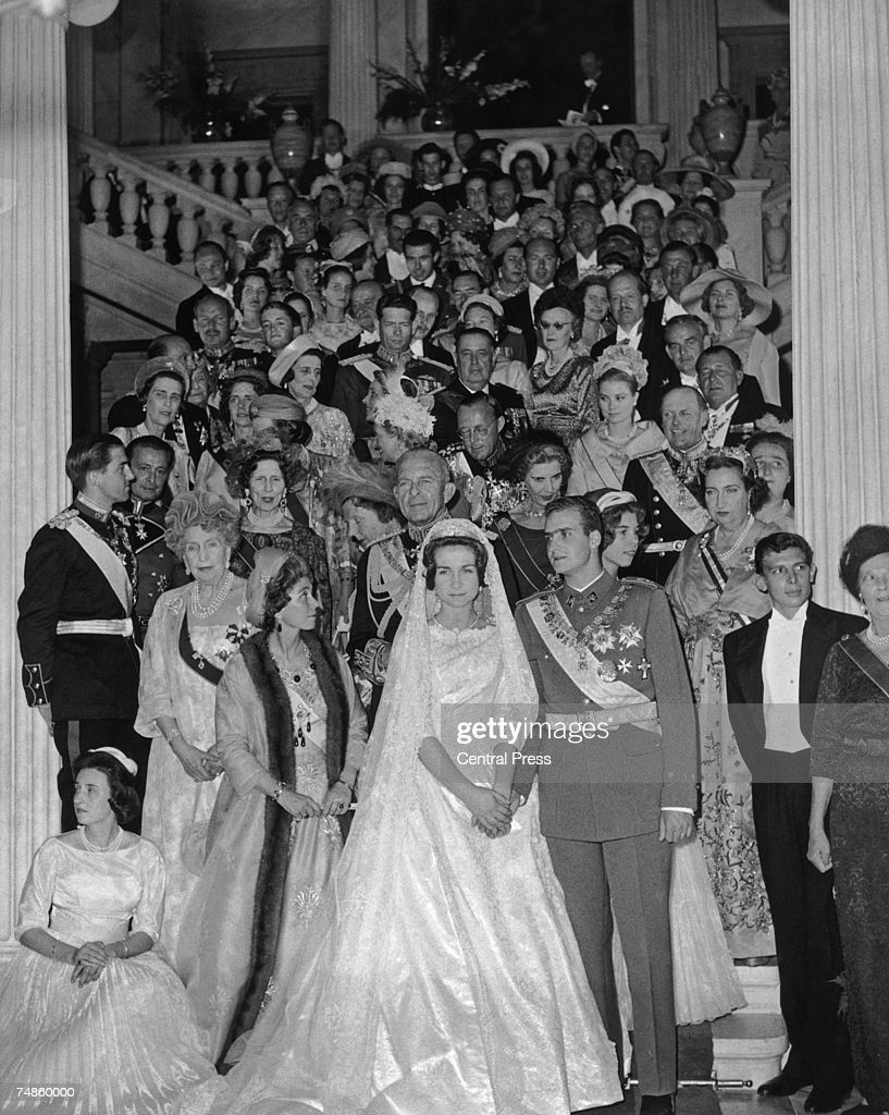 Prince Juan Carlos of Spain and Princess Sophia of Greece pose with their guests on the steps of the royal palace in Athens, after their wedding ceremony, 14h May 1962.