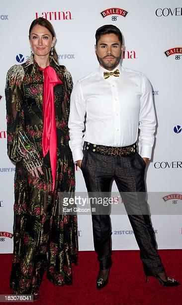 "Prince Julio Cesar Cruz, designer for Patric Love, stands alongside Mercedes Torres, modeling the line, at the Latina Magazine ""Hollywood Hot List""..."