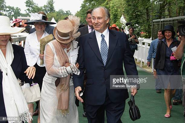 Prince Karim Aga Khan IV the hereditary Imam of the Shia Imami Ismaili Muslims and his daughter Princess Zahra walk together after 'Le Prix de Diane'...